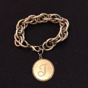 """Gold chunky bracelet with a """"T"""" on charm"""